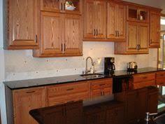 Backsplash For Black Cabinets - black granite and dark cabinets lighten up kitchen with white
