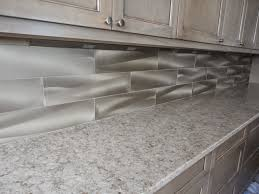 tile sarasota metaluxe tile install on a kitchen backsplash metaluxe tile install on a kitchen backsplash these tile have a metal coating on them with a brushed swirl finish the tiles can be cut on a normal tile