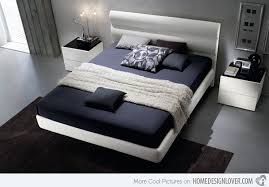 man grey bedroom with custom made bed and cute dark pattern pillow
