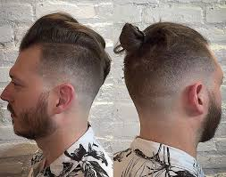 best hairstyles to grow an epic man bun or top knot man bun