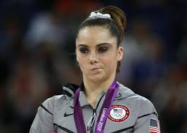 Frowning Meme - michael phelps olympic death stare vs mckayla maroney s not