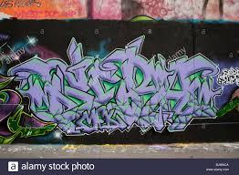paris france graffiti mural paintings on wall outside street paris france graffiti mural paintings on wall outside street abstract design