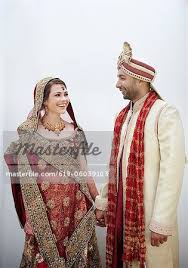 indian wedding groom and groom in traditional indian wedding clothing stock