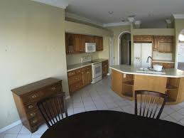 kitchen kirk hughes inc st louis mo quality home before this tampa bay area home is in a great location with a beautiful canal view the kitchen is caught in 1980 s beach house mode and lacks storage and