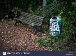 bench berlin berlin germany an old park bench and a trash can beschmierter
