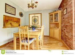 dining room with brick wall and corner cabinet stock photo image