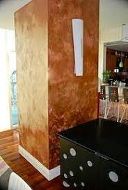 textured wall painted with copper metallic paint metallic paint