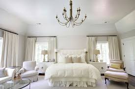 Chandelier In Master Bedroom Vibrant Master Bedroom Decor With Ruffle Duvet Also Metal