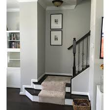 how to make a dark staircase or hallway feel brighter with paint