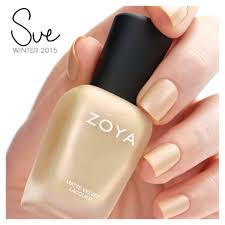sue by zoya nail polish is a soft champagne gold with a multi hued