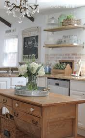 white brick backsplash black vent hood on white brick kitchen