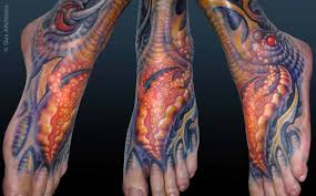 biomechanical leg tattoo designed by guy aitchinson design of
