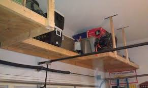 Simple Wood Storage Shelf Plans by Over Garage Door Shelf Above Garage Door Storage Landscaping