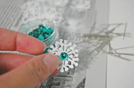 how to make a paper snowflake ornament diy the