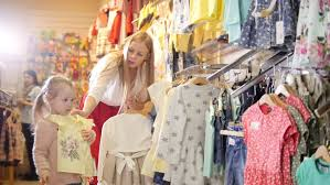 woman shopping in a clothing store for children children u0027s