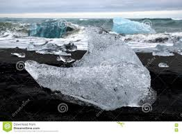 Black Sand Beaches by Iceberg On Black Sand Beach Glacier Lagoon Iceland Stock Photo