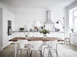 kitchen island with built in table appliances modern white design with subway tile backsplash white