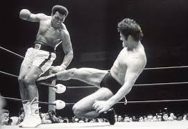 a japanese man pass by the japanese pro wrestler who almost got muhammad ali u0027s leg