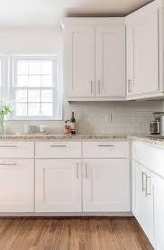 terrific white kitchen cabinets dark granite countertop brick