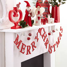 merry wooden garland by the home