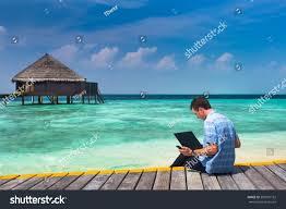 man laptop mobile sitting on wooden stock photo 385591162