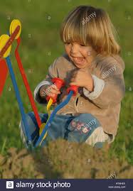 baby little boy playing outside in the garden park yard grass fun
