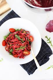 herb buttered beet noodles with sautéed mushrooms arugula the