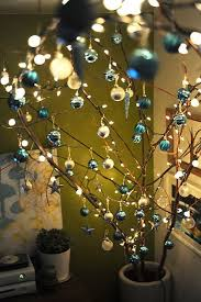 christmas branches with lights branches with ornaments in large crock christmas branch display