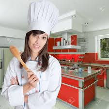 chef cuisine femme chef holding a wooden spoon in a beautiful kitchen