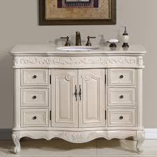 gorgeous white bathroom vanity set with carved wood cabinets and