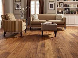 small living room design with wide plank distressed wood flooring
