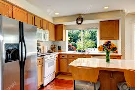 kitchen cabinet colors with white appliances cozy kitchen with honey color cabinets white appliances and