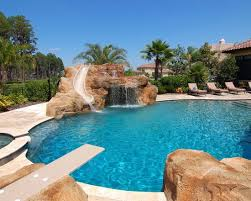 awesome backyard pools amazing mediterranean pool with diving board slide waterfal and
