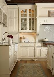 white kitchen cabinets with taupe backsplash what to do when you secretly kitchen cabinets