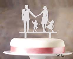 wedding cake toppers bride groom and child wedding cake topper