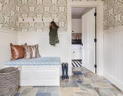 mudroom floor ideas mudroom with wallpaper and beaboard wainscoting cottage