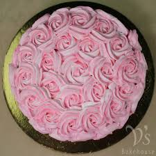 chocolate cake with freshcream filling and frosting with pink