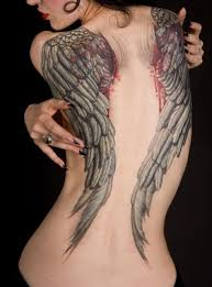 with broken wings tattoos and