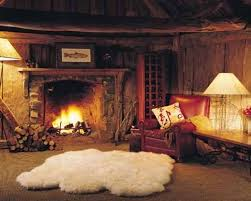 Fire Retardant Rug Sheepskin Rug In Front Of A Roaring Fire Log Cabins And Barns