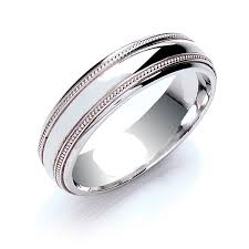 18ct white gold wedding ring 18ct white gold 6mm court shape heavier mill grain pattern edge