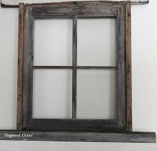Christmas Decorations For A Window Sill by Anchoring A Christmas Mantel With An Old Weathered Window Frame