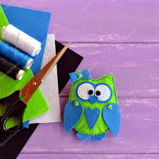 felt owl ornament owl is sewn from green and blue felt and
