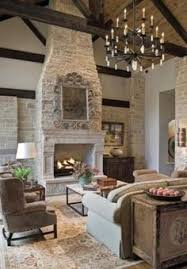 Living Room Fireplace Design by Rustic Great Room With Stone Fireplace And Wall Of Windows