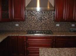 Kitchen Backsplash With Granite Countertops by Countertops Brown Cabinets Creame Granite Countertop Stainless