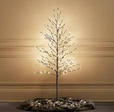 starlit trees from restoration hardware home for the holidays