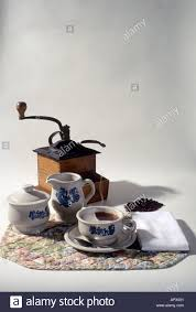 Old Fashioned Coffee Grinder An Old Fashioned Coffee Grinder And Serving Dishes Stock Photo