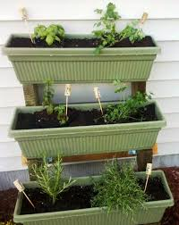 tiered herb garden made with stair stringers and window box