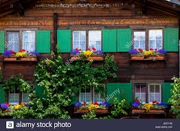 typical swiss wooden alpine chalet style house with inscription in