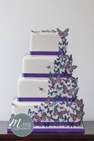 A wedding cake with purple butterfly cascade took to the stage