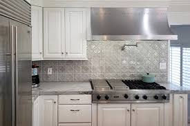 white kitchen cabinets with stainless steel backsplash classic white kitchen with spectacular storage
